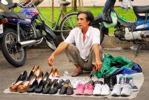 Shoes selling along a street in Saigon